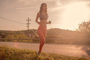One young woman outdoors jogging run