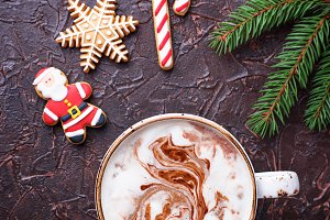 Christmas background with latte and gingerbread cookies