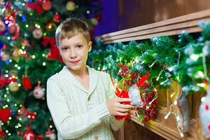 Waiting for present. Pleasant euphoric little boy and holding ha