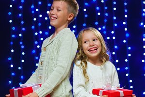little children in costume holding boxes with gifts. New Year. M