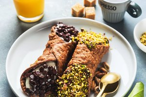 Cannoli with ricotta, chocolate and pistachios. Italian pastries