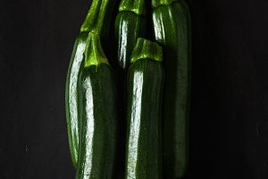 Zucchini isolated on black