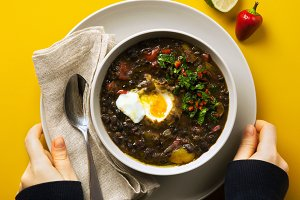 A bowl of homemade chili bean soup with with poached egg