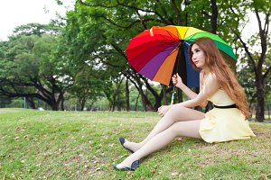 Woman with umbrella and sitting