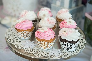 Cupcakes on plate on buffet