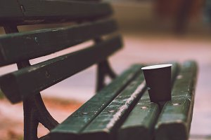 Empty cup of coffee on the bench
