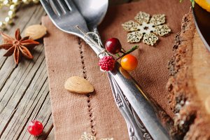 cutlery on wooden table with New Year's and Christmas decorations, selective focus