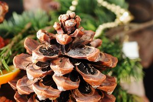 fir cone wood table with Christmas and Christmas decorations, selective focus