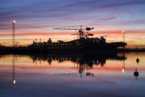 Sunrise above a shipyard