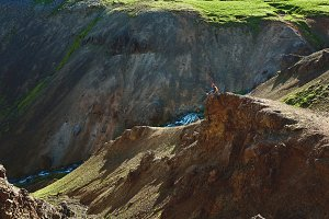 woman traveler on a walk in the Valley of the river of Hveragerdi Iceland