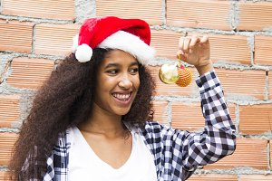 afro woman with santa hat