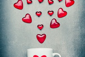 Mug and red hearts arrow