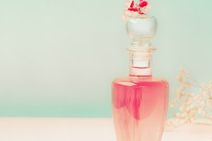 Pink Cosmetic bottle with flowers