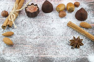 Chocolate, nuts and spice on snow