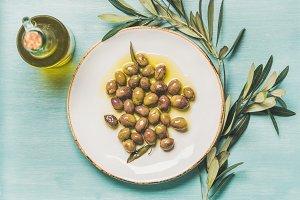 Pickled green olives, olive tree branch