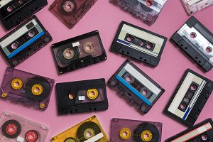 Old cassette tape on lilac surface, top view. Creativity Concept