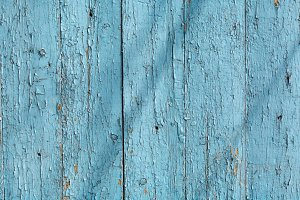 Wooden surface with blue paint, creative abstract texture