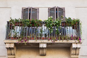 Beautiful window decorated with red flowers .