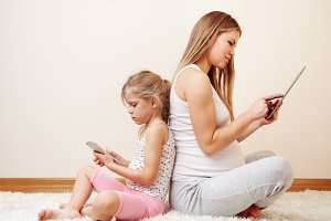 Mum and child with gadgets