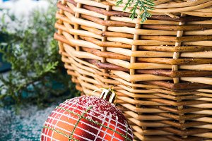 Christmas greeting card with basket and bauble