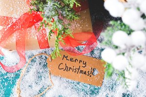 Merry Christmas greeting card with gift