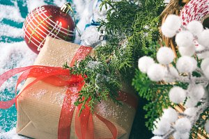 Basket full of Christmas decorations. Gift box