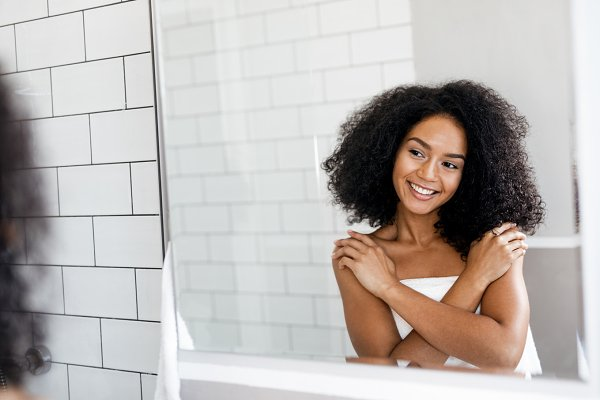 Happy woman looking at mirror | High-Quality Beauty & Fashion ...