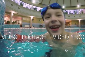 Joyful boy in the swimming pool