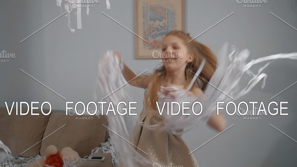 Happy Girl Dancing With Paper Confetti