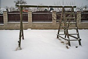 Wooden swing in winter