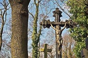 Metal cross in a cemetery