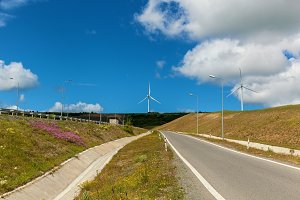 power turbines of green energy along the road