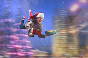Incredibly happy girl flying with gifts in hand. Christmas hat. Background, speed, night city. The concept of Christmas sales, new year discounts