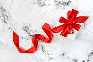 White gift box red ribbon bow