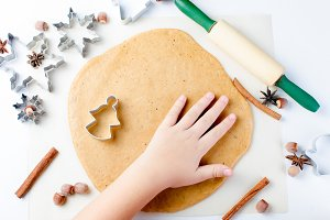 Cutting the gingerbread cookie dough