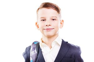 Happy schoolboy with backpack isolated on white