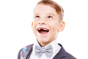 Excited school boy with toothless smile looking up
