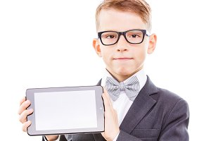 Cute schoolboy in glasses shows tablet PC screen