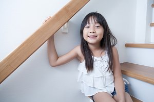 Girl sitting in on the ladder