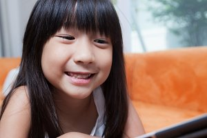 Girl playing with tablet.