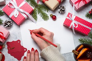 Woman write wishes to xmas.