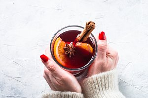 Woman hold Mulled wine