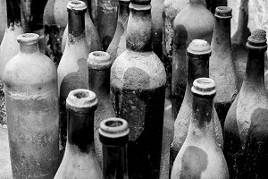 Very old bottles in black and white