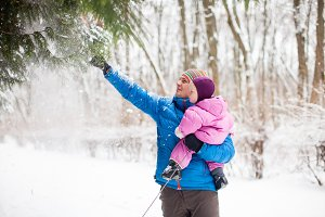 Father and daughter outdoors on winter snowy day