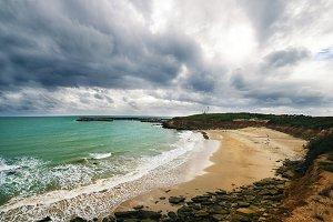 Beach with cloudy sky