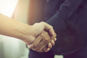 Joint Hands of Two Businessmen.