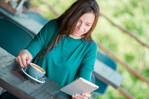 Young woman in outdoor cafe