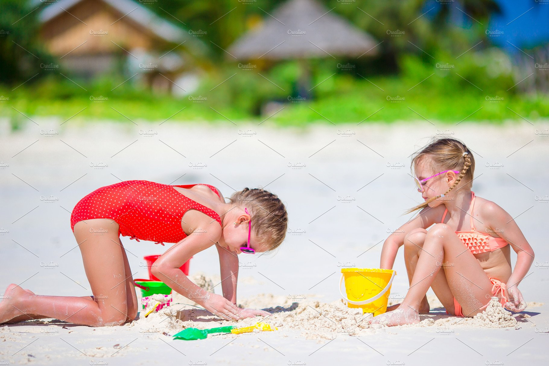 Beach Toys For Girls : Adorable little girls during summer vacation kids playing