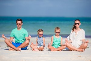 Young family on vacation have a lot of fun. Parents with kids in yoga