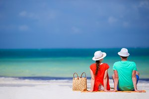 Young family of two on white beach